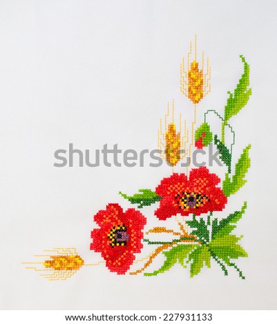 embroidered cross-stitch flowers on canvas patterns  - stock photo