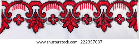 embroidered cross-stitch pattern, ukrainian ethnic ornament  - stock photo