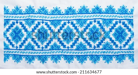 embroidered cross-stitch pattern, ukrainian ethnic ornament, in blue colors - stock photo