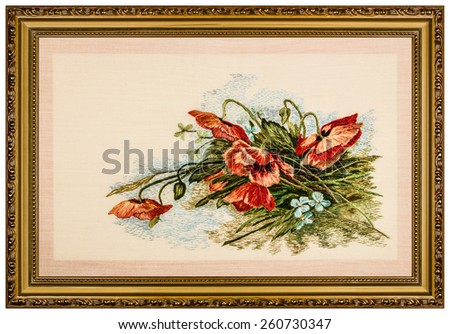 Embroidered picture in the frame, isolated on white background - stock photo