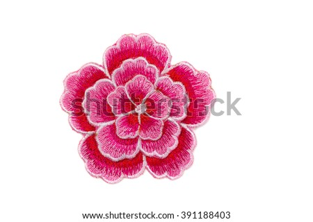 Embroidered red flower. Isolate on white. - stock photo