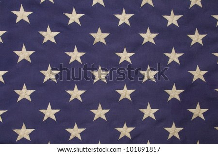 Embroidered white stars on a field of blue which represents the union on the American flag - stock photo
