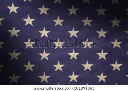 Embroidered white stars on a field of blue which represents the union on the American flag, lit diagonally - stock photo