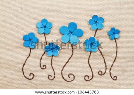 Embroidery pattern on fabric - stock photo