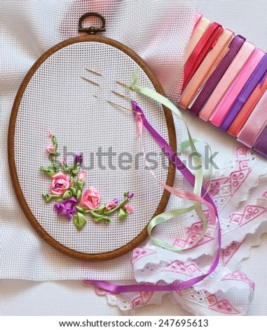 Embroidery ribbons. Accessories: canvas, tambour, needles and kit of satin ribbons - stock photo