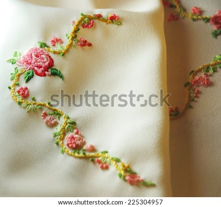 Embroidery roses and flowers - stock photo