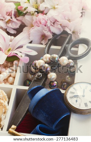 embroidery vintage  accessories with flowers and pearls - stock photo
