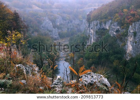 Emen canyon near the city of Veliko Tarnovo in Bulgaria on a raw foggy morning in the fall - stock photo