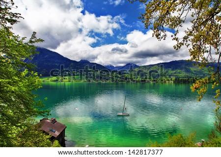 emerald Alpine lakes. Austria. St.Wolfgang - stock photo