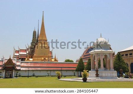 Emerald Buddha Temple is the most sacred Buddhist temple, a potent religion-political symbol and the palladium of Thai society.  - stock photo