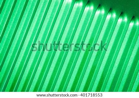 emerald green glitter covered metal panel closeup - stock photo