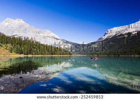 Emerald Lake is located in Yoho National Park, British Columbia, Canada. It is the largest of Yoho's 61 lakes and ponds, as well as one of the park's premier tourist attractions.  - stock photo