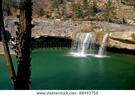 Emerald lake of the waterfall Zarecki krov - stock photo