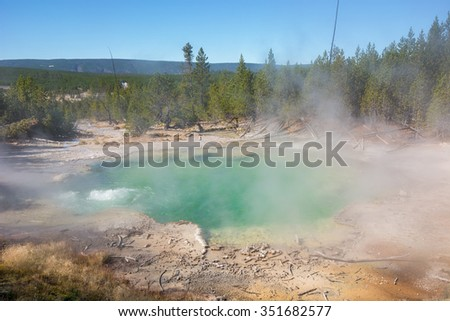 Emerald Spring in Norris Geyser Basin at Yellowstone National Park, Wyoming. - stock photo