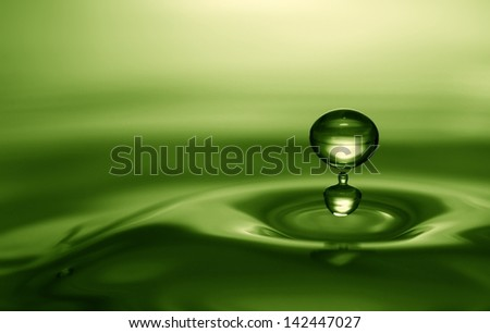 Emerald water drop - stock photo