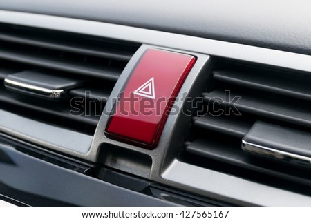 Emergency button in the car. - stock photo