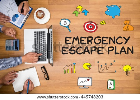 Emergency Escape Plan Business team hands at work with financial reports and a laptop - stock photo