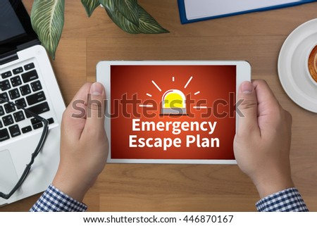 Emergency Escape Plan man hand Tablet and coffee cup - stock photo