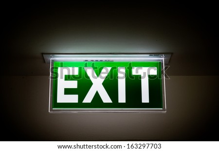 Emergency exit sign in a building - stock photo