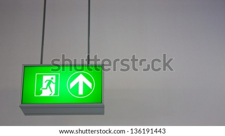 Emergency exit sign in modern offices inside an industrial plant - stock photo