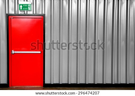 Emergency Exit with Exit Sign and Fire Extinguisher - stock photo