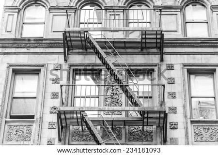 emergency ladder in building of new york city - stock photo