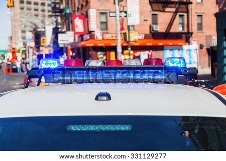 emergency lights of a police car in New York City - stock photo