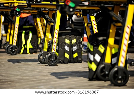 Emergency medical equipment detail shot with several stretcher in a row - stock photo