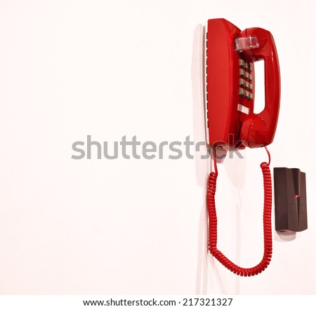 Emergency phone hanging on a wall. - stock photo