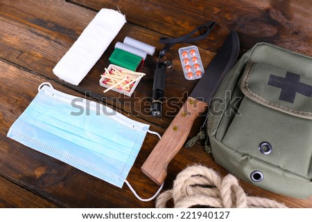 Emergency preparation equipment on wooden background - stock photo