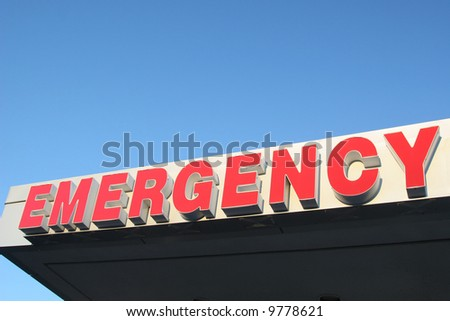 Emergency sign above an emergency entrance of a hospital. - stock photo