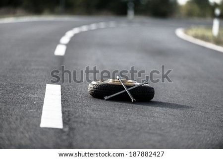 Emergency tyre on the road at breakdown - stock photo
