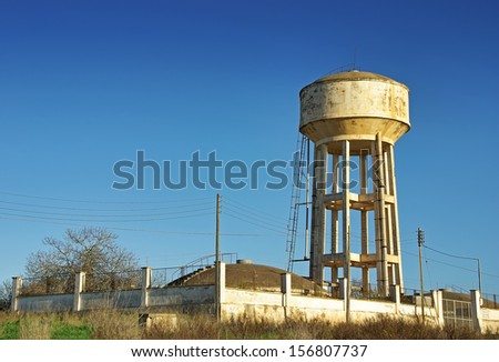 Emergency Water Tank elevated over a mortar structure - stock photo