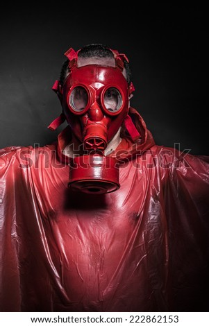 emission nuclear concept, man with red gas mask - stock photo