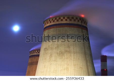 Emissions of thermal power plant at night - stock photo