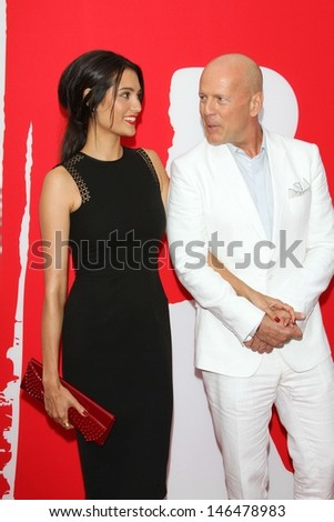 """Emma Heming and Bruce Willis at the premiere of Summit Entertainment's """"RED 2,"""" Village Theater, Westwood, CA 07-11-13 - stock photo"""