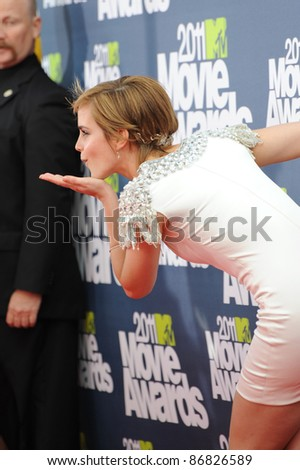 Emma Watson arrives at the 2011 MTV Movie Awards at the Gibson Amphitheatre, Universal Studios, Hollywood. June 6, 2011  Los Angeles, CA Picture: Paul Smith / Featureflash - stock photo