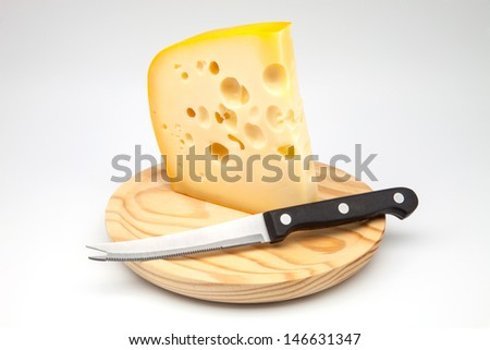 Emmental cheese on a  cutting board - stock photo