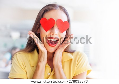emoji concept: woman with the hearts instead of her eyes - stock photo