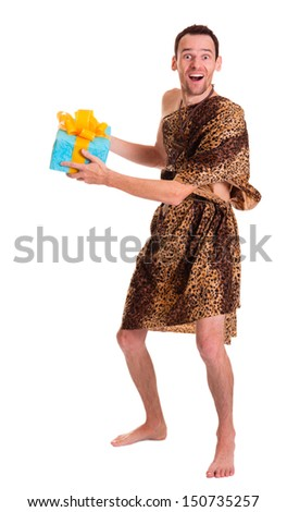 Emotional and happy wild funny man in animal fell with present or gift pack isolated on white background - stock photo