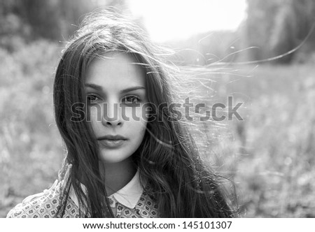 emotional black and white portrait of a young girl - stock photo
