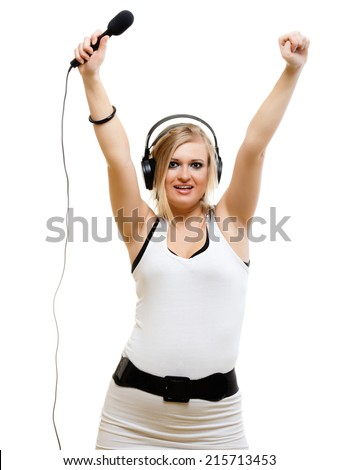 emotional blonde girl singer performer musician singing a song to microphone isolated on white. young rockstar with headphones. - stock photo