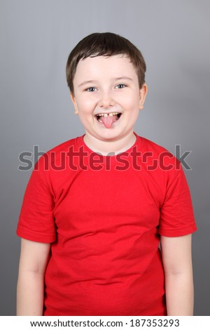 Emotional boy on a gray background - stock photo