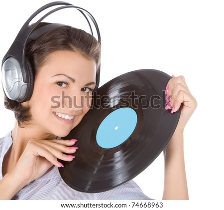 emotional brunette in headphones with vinyl record over white - stock photo