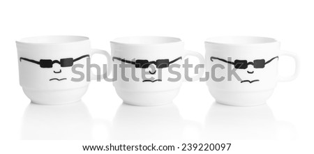 Emotional cups isolated on white - stock photo