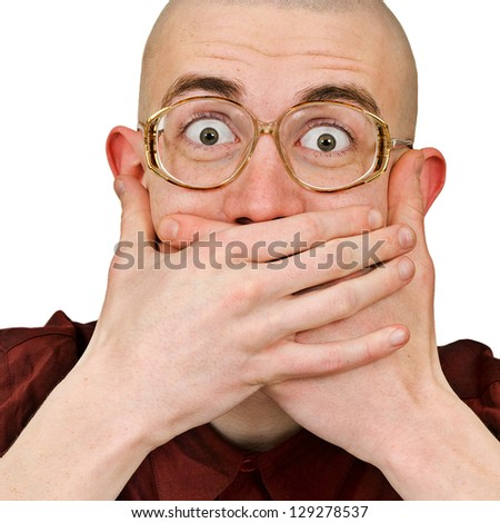 Emotional excited man in eye glasses keep his mouth closed by his hands isolated on white background - stock photo
