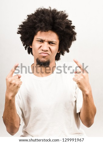 Emotional facial expression of man - narcissistic - stock photo