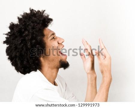 Emotional facial expression of man - singing - stock photo