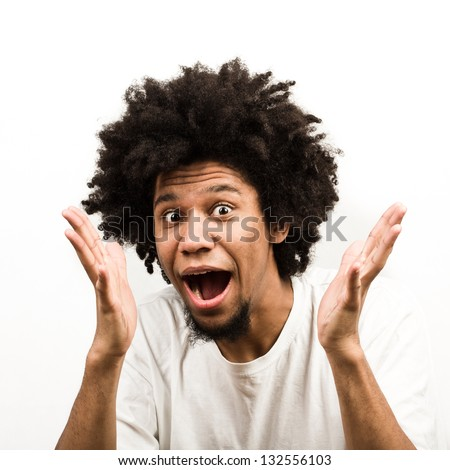 Emotional facial expression of man - surprised - stock photo