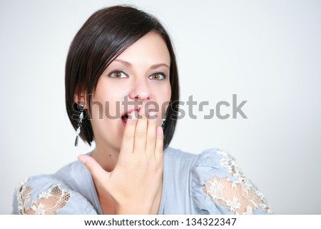 Emotional girl a on white background - stock photo